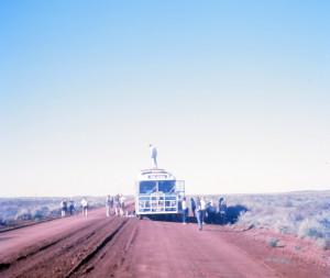 A broken spring brings the bus to a halt, twenty miles from Onslow, Western Australia